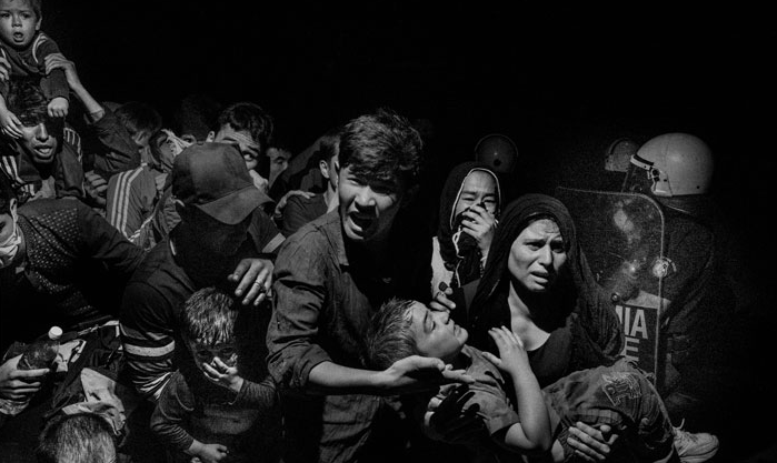 © GREECE. Lesbos. 2015. Refugees and migrants arriving on Lesbos island are transferred to Moria refugee camp to registration from authorities before they can move on. (c) Alex Majoli/ Magnum Photos